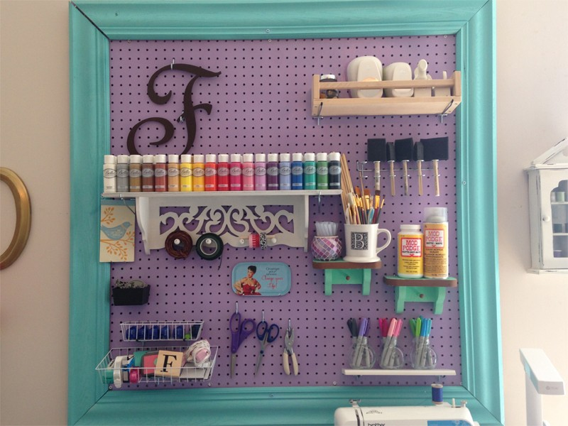 craft room organization with framed pegboard 19