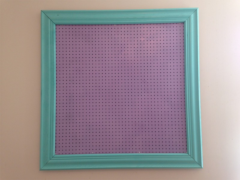 craft room organization with framed pegboard 4