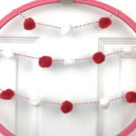 Valentine's Wreath using Embroidery Hoop and Pom Pom Garland